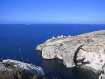 Blue Grotto and Filfla - Malta. Blue Grotto and the small island of Filfla in the background (Malta) shot from above in a clear summer morning Stock Image