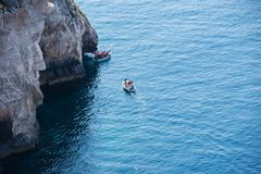 Blue Grotto boat trip, Malta. BLUE GROTTO, MALTA - AUGUST 23, 2017: Tourists taking a boat trip at the Blue Grotto. The sea caves of Blue Grotto and natural arch Royalty Free Stock Photography
