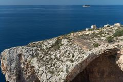 Cape with Blue Grotto in Malta. Blue Grotto in Malta. Island of Filfla in the distance Royalty Free Stock Photo