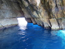 Blue Grotto. The Blue Grotto in Malta is a water filled cave in a cliff where the sea appears blue due to the effects of sunlight on the waters within stock photos