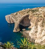 Blue Grotto - one of nature landmarks on Malta island. With deep blue ocean and horizon Stock Photo