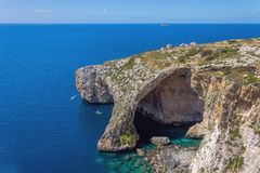Blue Grotto rock cliff arch in Malta, aerial view from the Mediterranean Sea to the island.  stock image