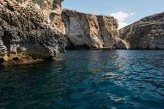 Blue grotto seen from a boat trip. Malta. Blue grotto caves and cliffs seen from a boat trip. Malta Stock Photo