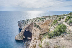 Blue Grotto on the southern coast of Malta. Blue Grotto (Taht il-Hnejja) cavern on the southern coast of Malta, near the village of Zurrieq and the small Stock Photo