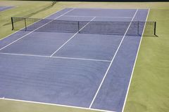 Blue ground tennis court. hard, Plexipave, Rebound Ace, DecoTurf, TeraFlex, AC Play. Blue ground tennis court. Plexipave, Rebound Ace, DecoTurf, TeraFlex AC Play Royalty Free Stock Photos