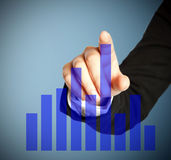 Blue growth graphic on touch screen Royalty Free Stock Photos