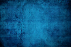 Blue Grunge Background. A rough, textured blue grunge background Royalty Free Stock Photo