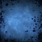 Blue grunge background with splatters Royalty Free Stock Photos