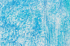 Blue grunge background. Under the blue paint rayed white paint Stock Photography