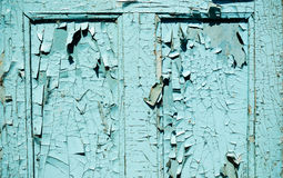 Blue grunge door with cracked paint Stock Photography