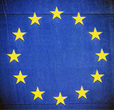 Blue grunge European Union stars. Vintage European Union stars glare on dark blue grunge textures Royalty Free Stock Photo