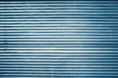 Blue grunge lined metal wall, background or texture Royalty Free Stock Photo