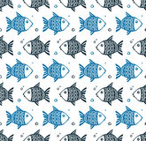 Blue grunge style fishes floating different directions, vector seamless pattern Stock Photography