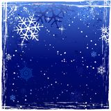 Blue grunge winter background. Winter background with snowflakes and Stock Image
