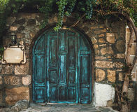 Blue grunge wooden door in brick wall Royalty Free Stock Photography