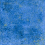 Blue grungy background with yellow spots Royalty Free Stock Image