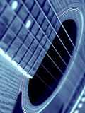 Blue guitar. Monochromatic image of soundboard on an acoustic guitar Royalty Free Stock Images