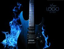 Blue guitar with fire on dark background