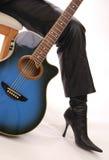 Blue Guitar and High Heeled Boot Stock Photos