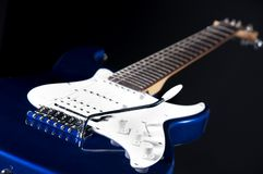 Blue Guitar Isolated On Black Royalty Free Stock Images