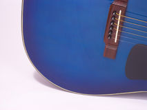 Blue guitar1. A blue acoustic guitar Royalty Free Stock Images