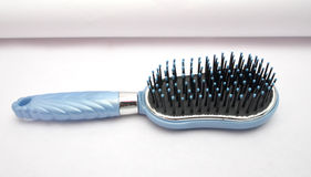 Blue hair comb Royalty Free Stock Photos