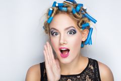 Blue hair curlers stock image