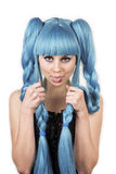 Blue hair expressive woman with her tongue out Royalty Free Stock Photo