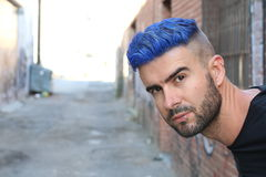 Blue haired guy walk on old rusty forsaken barges Stock Photos