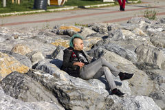 A blue haired punk rocker on a shore, Istanbul Royalty Free Stock Photography