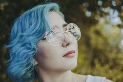 Blue-haired Woman Taking a Selfie royalty free stock photography