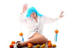 Blue hairs girl and fruits Royalty Free Stock Photos