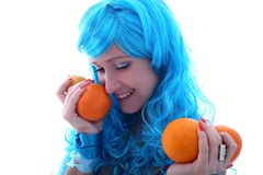 Blue hairs girl with oranges Royalty Free Stock Photography