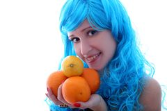 Blue hairs girl and oranges and lemons Stock Photos