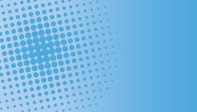 Blue Halftone Dots. Circle on faded blue background Royalty Free Stock Images