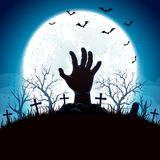 Blue Halloween background with hand and moon Royalty Free Stock Images