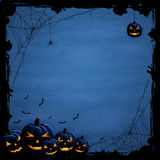 Blue Halloween background with pumpkins Stock Photos