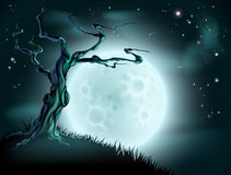 Blue Halloween Moon Tree Background. A spooky scary blue Halloween background scene with full moon, clouds, hill and scary tree Royalty Free Stock Photos