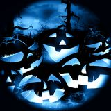 Blue halloween night with pumpkins Royalty Free Stock Images