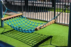 A blue hammock on the background of green grass stock photo