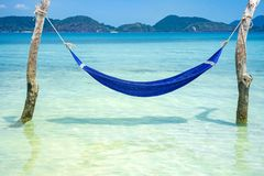 Blue hammock on tropical beach for summer and vacation.  Royalty Free Stock Image