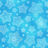 Blue hand-drawn snowflakes seamless pattern Stock Photos