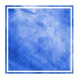 Blue hand drawn watercolor rectangular frame background texture with stains. Modern design element royalty free stock photo