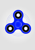 Blue hand spinner fidget toy. Drawing. Toy for stress relief and improvement of attention span Stock Photo