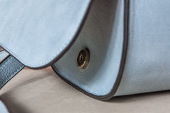 Blue handbag, delicate and feminine. Trouser suits and dresses Stock Photos