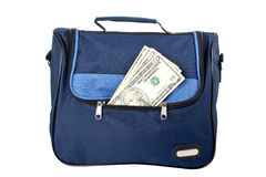 Blue handbag with money Royalty Free Stock Images