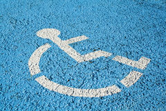 Blue handicap parking sign. Blue handicap parking or wheelchair accessible sign in parking Royalty Free Stock Photos