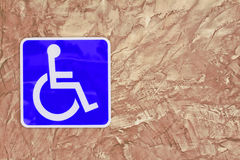 Blue handicap parking or wheelchair on wall brick . Blue handicap parking or wheelchair on wall brick textured background Royalty Free Stock Photos