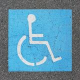Handicapped parking sign paint on asphalt Royalty Free Stock Photos