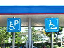 Blue handicapped parking sign at petrol station. Close up blue handicapped parking sign at petrol station in Thailand royalty free stock images